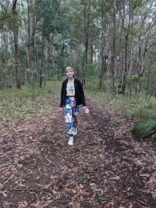 Aasha walking in the forest